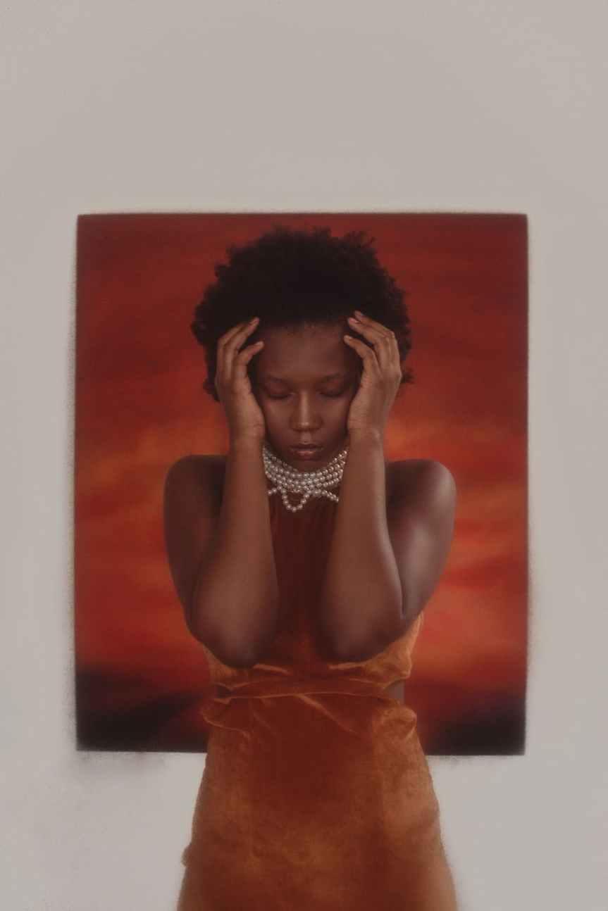 anxious woman wearing orange dress