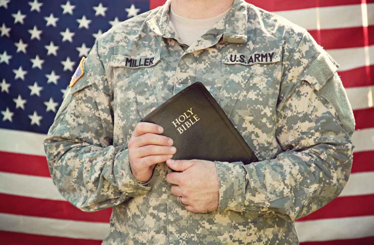 U.S. Army man holding Bible