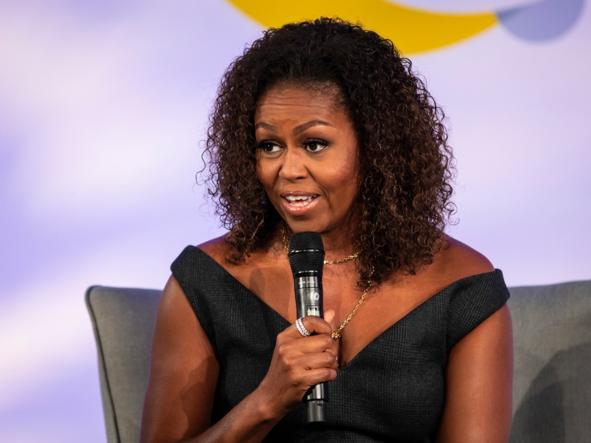 """Former first lady Michelle Obama said Tuesday that white Americans are """"still running"""" from minority communities when they move to another neighborhood."""